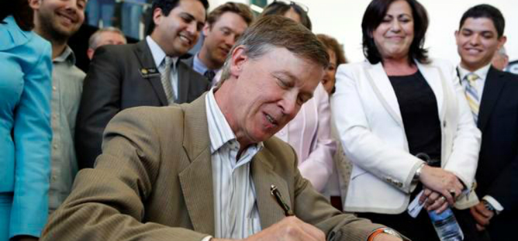 Gov. John Hickenlooper signing a bill into law in 2013.
