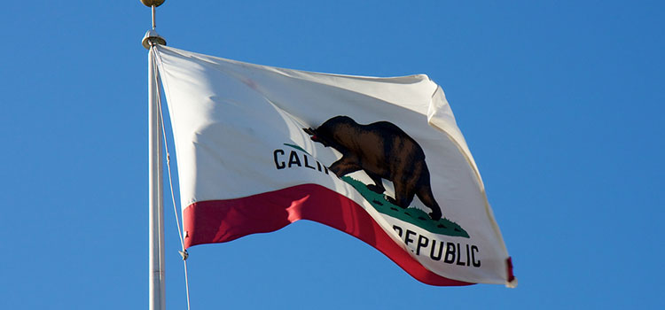 The flag of California flying in the wind.