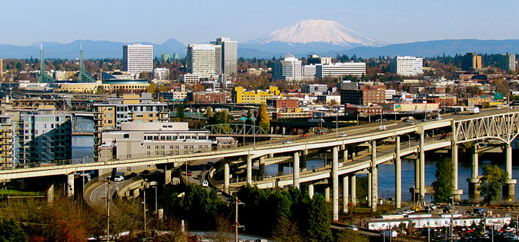 Skyline view of Portland, Oregon, with snow-capped Mt. Hood on the eastern horizon.