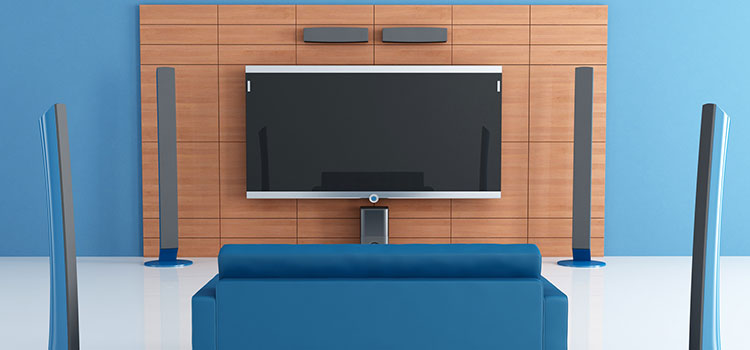 Contemporary blue home theater with couch.