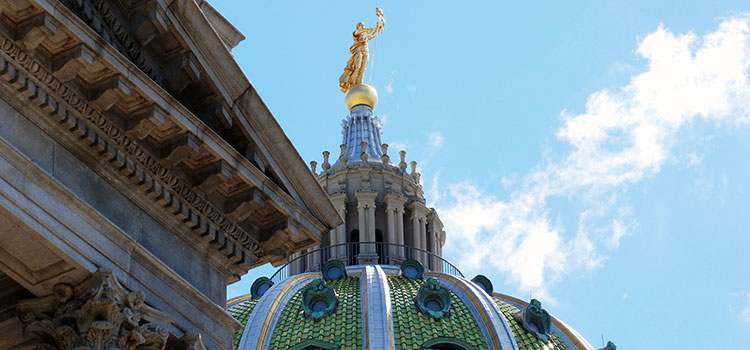 View of the statue on top of the Pennsylvania capitol building in Harrisburg.