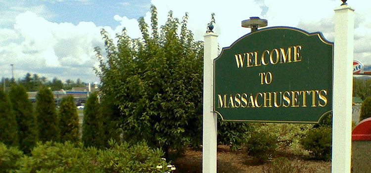 "Sign reading ""Welcome to Massachusetts"" on the Massachusetts state line."