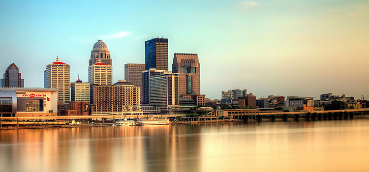 View of Louisville, Kentucky at dusk from across water.