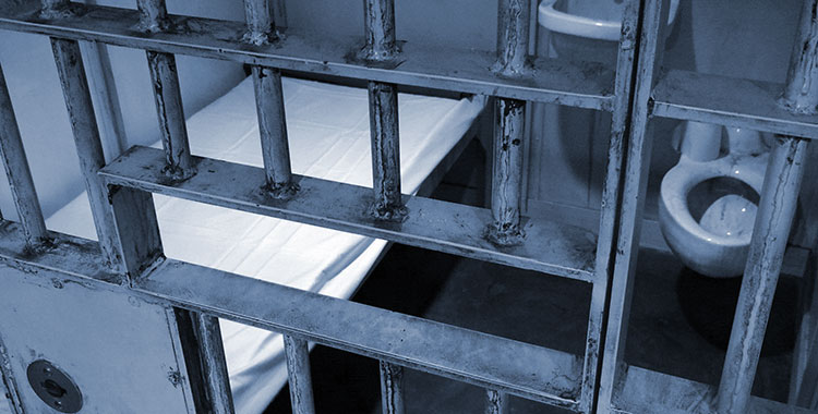 Image depicting the inside of a high security prison cell.