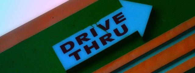 An old fashioned Drive-Thru sign.