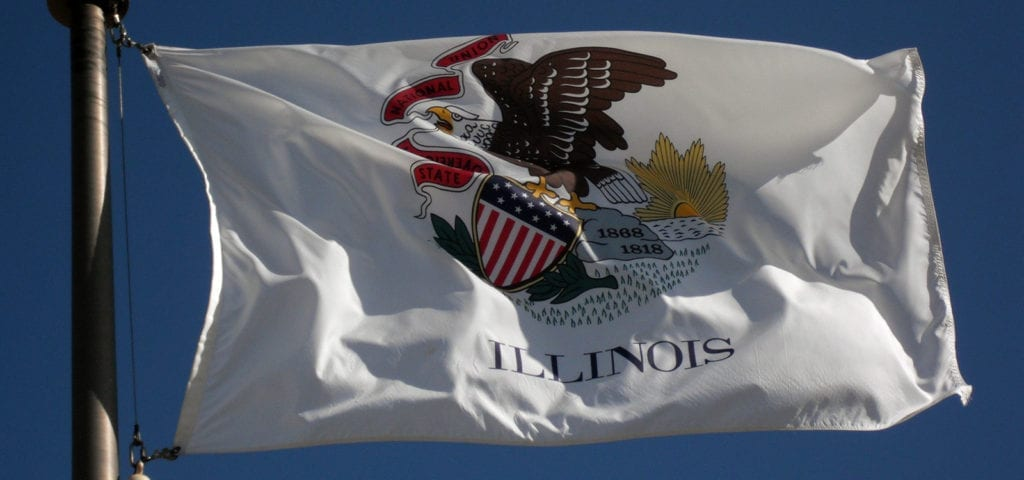 The state flag of Illinois flying on a clear day.