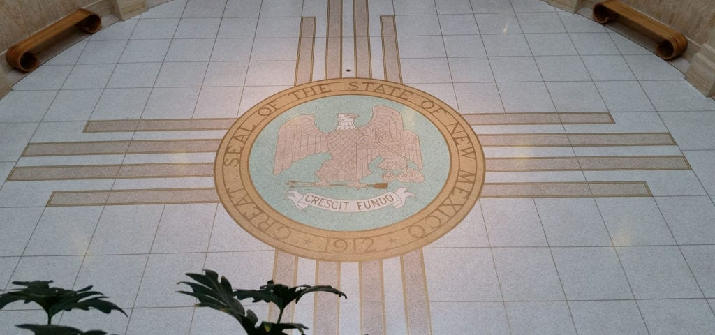 The official state seal of New Mexico, on the floor of the state's capitol building in Santa Fe.