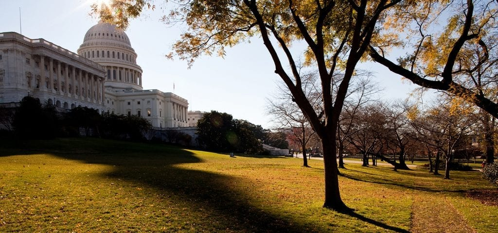 The U.S. Capitol Building in Washington D.C. on an autumn day.