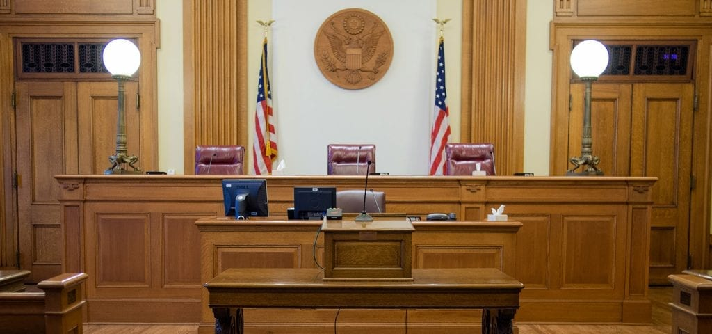 Empty judge's chair inside of a U.S. court room.