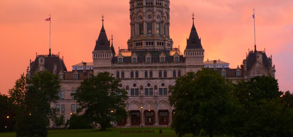 The Connecticut Capitol Building during a pink-toned sunset.
