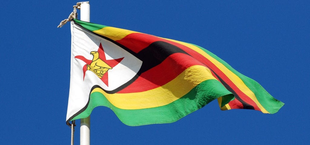 Official flag of Zimbabwe, featuring a soapstone bird and a red star.