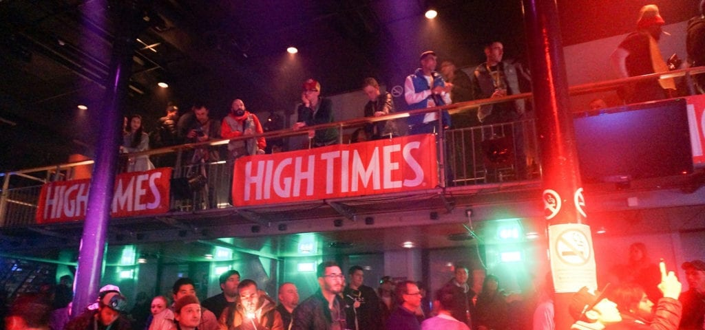 Event attendees smoke and enjoy a concert at a High Times Cannabis Cup.