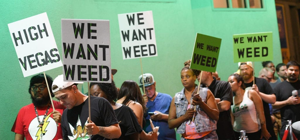 Cannabis enthusiasts line up outside of the NuLeaf dispensary in Las Vegas, Nevada on the night of first adult-use sales.