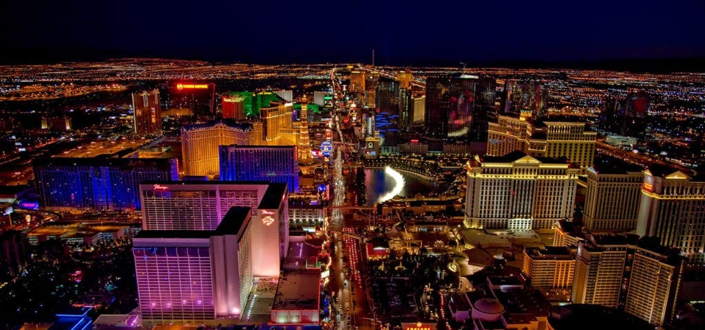 An aerial and nighttime view of the Las Vegas city skyline.