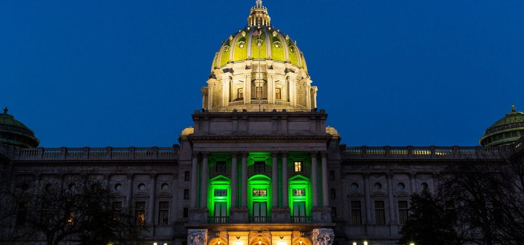 The Pennsylvania Capitol Building lit up with green lights to celebrate the House passage of the state's medical cannabis law in 2016.