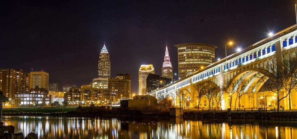 Nighttime photo of Cleveland, Ohio and the lights reflecting off the river.