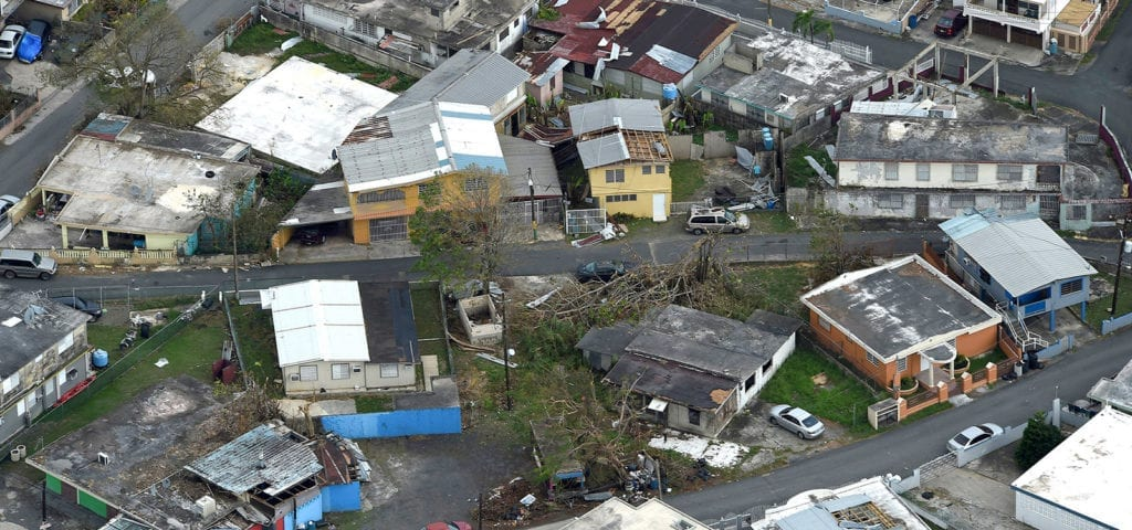 An aerial image of damaged homes and communities in the destructive path Hurricane Maria.