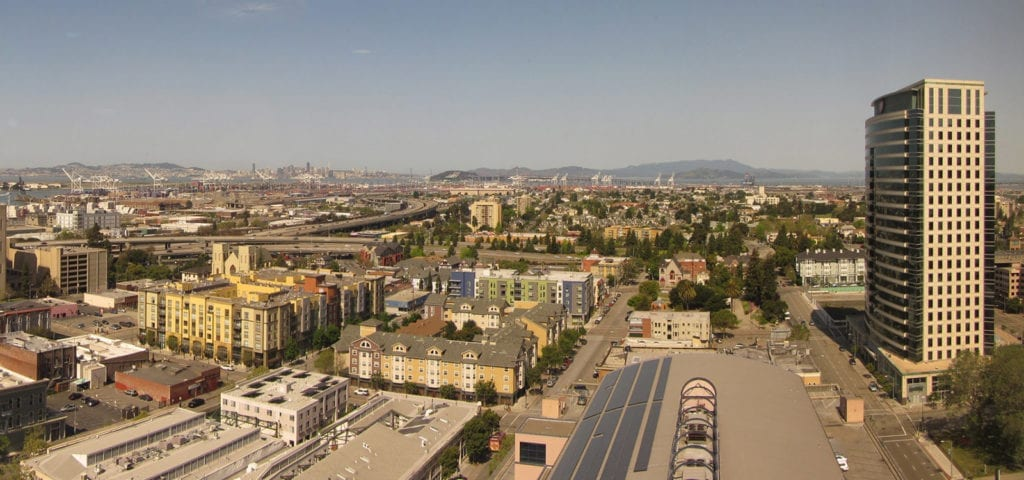 Skyline view of Oakland, California on a clear, sunny day.