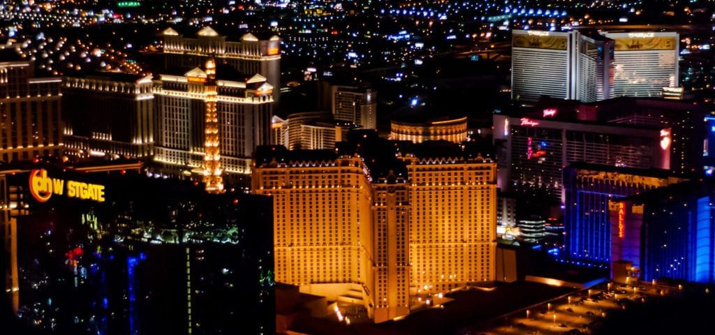 Photograph captured from a helicopter flight over Las Vegas during the nighttime.