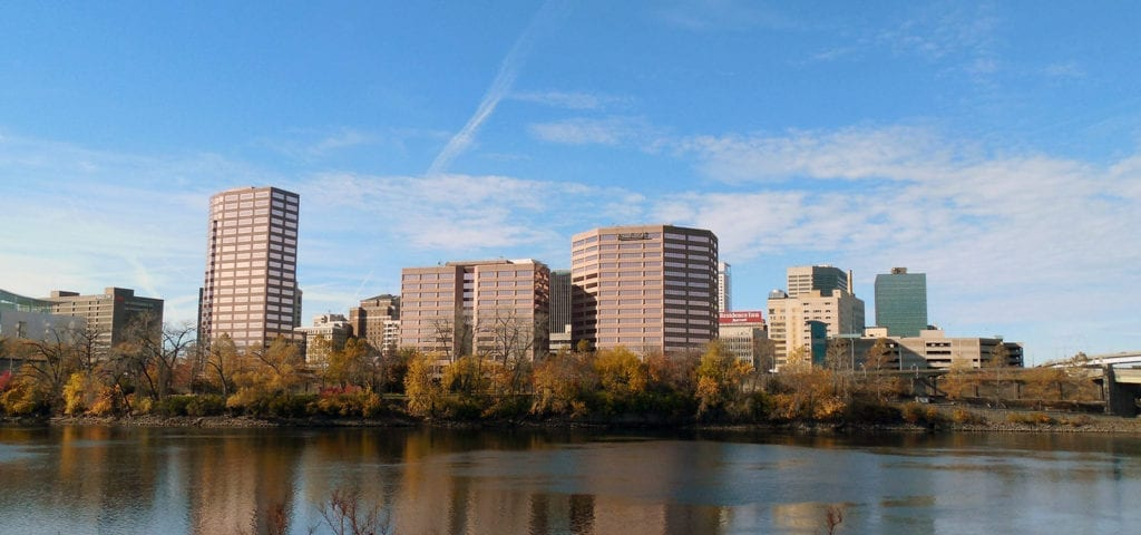 Photograph of buildings in Hartford, Connecticut from across a wide river.