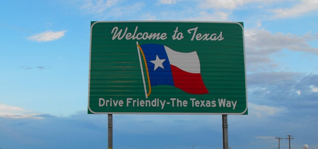"""A road sign that says """"Welcome to Texas."""""""