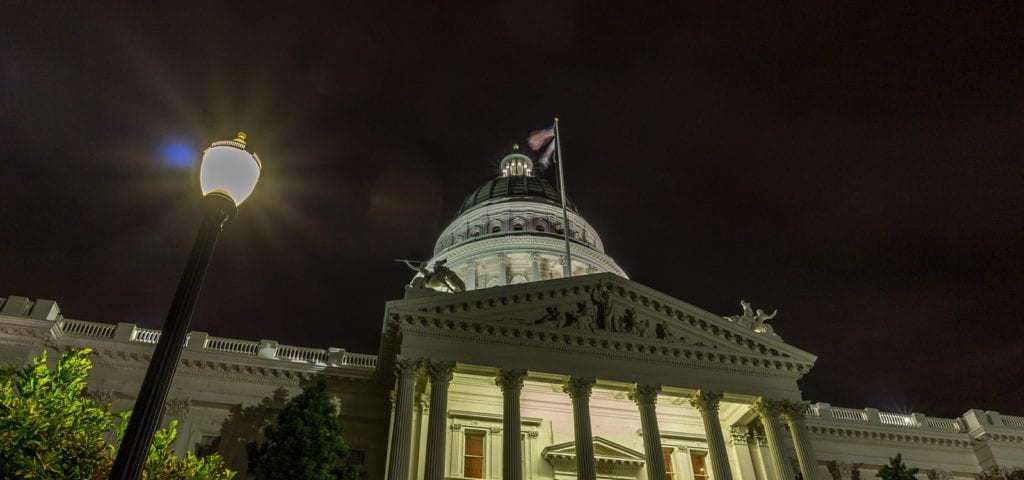 The California State Capitol Building in Sacramento, California photographed at nighttime.