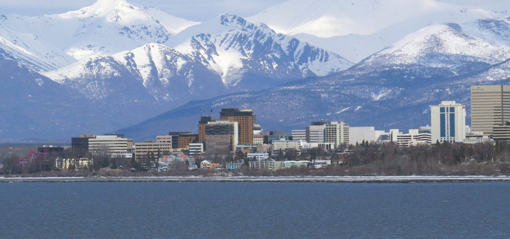 Downtown Anchorage, Alaska photographed from a boat several hundred meters from the shore.