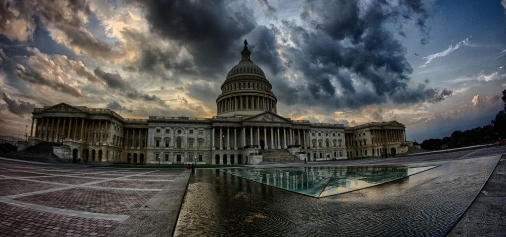 "Photograph of Capitol Hill in Washington D.C. distorted by a ""fish-eye"" lens."