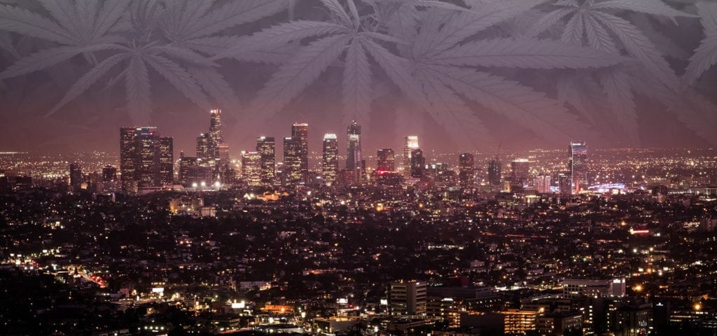 The night skyline of Los Angeles, California in a digital collage with a black and white picture of cannabis foliage.