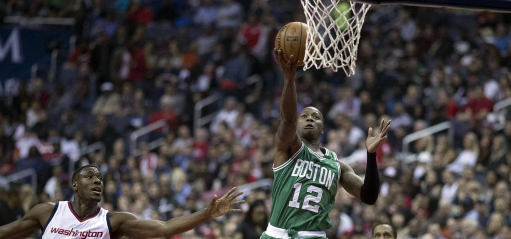 Terry Rozier, an NBA player for Boston, jumps up for a 2-point layup.