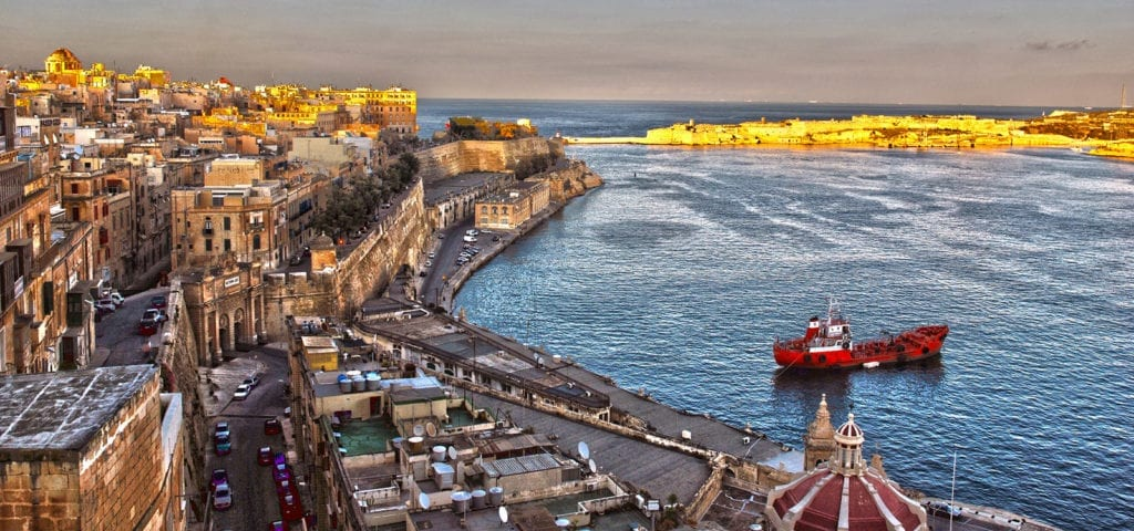 Sunset photo of the bay behind Valletta — Malta's capital city.
