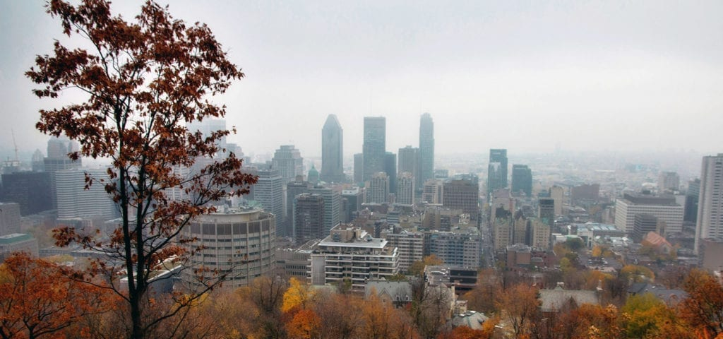 View of Montreal, Quebec from a faraway hillside on a foggy day.