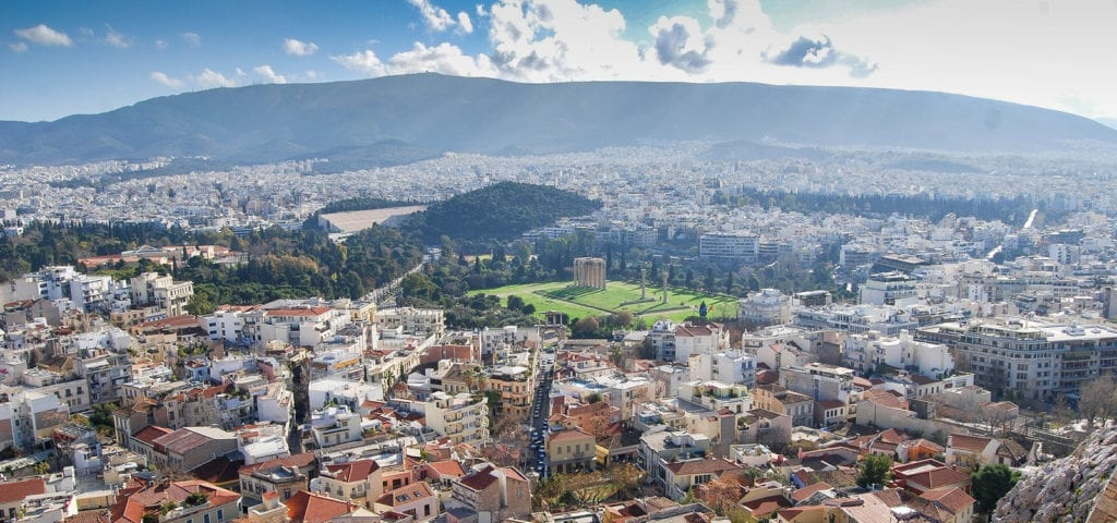 The Athens, Greece skyline, photographed on a clear, sunny day.
