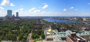 Photo of the Boston city skyline on a clear, sunny day.