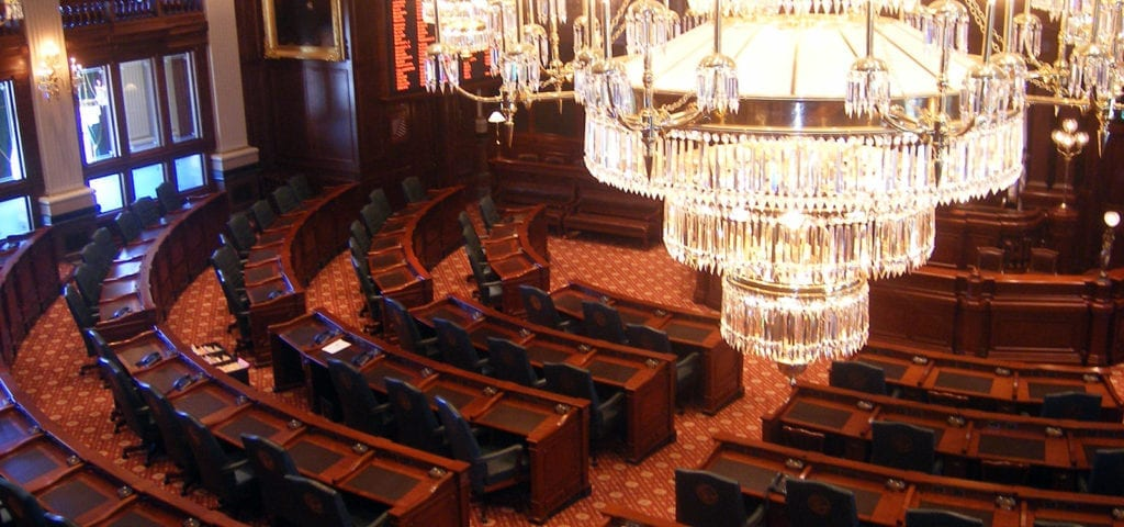 Chandelier and legislative hall inside of the Illinois Capitol Building.