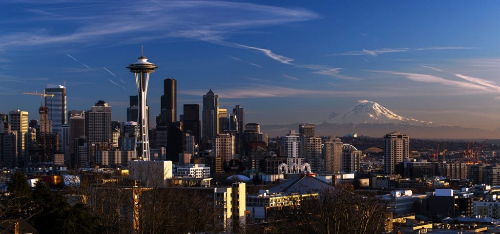 Photograph of downtown Seattle with Mt. Rainier in the background.
