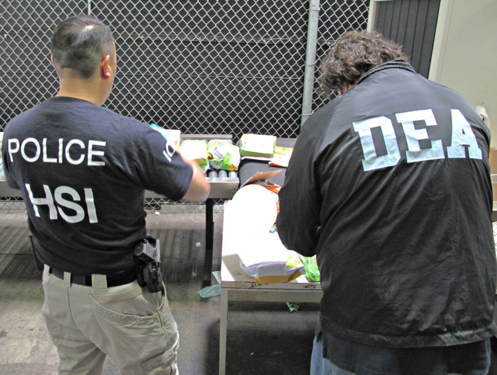 101315: Synergy III – 0006: DEA investigator teams up with ICE agent during Project Synergy III in Los Angeles, October 13, 2014.